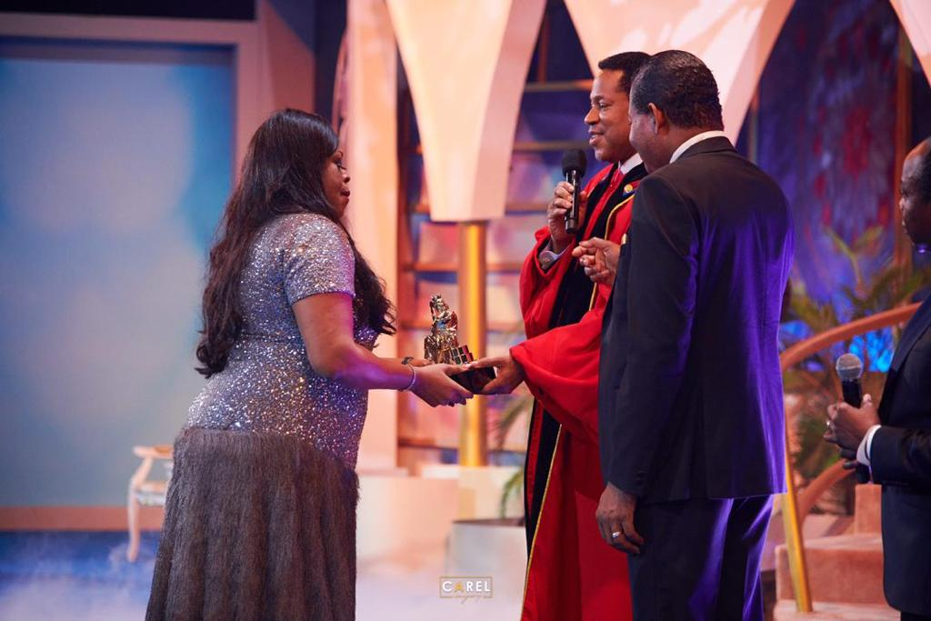 Image result for sinach receiving award